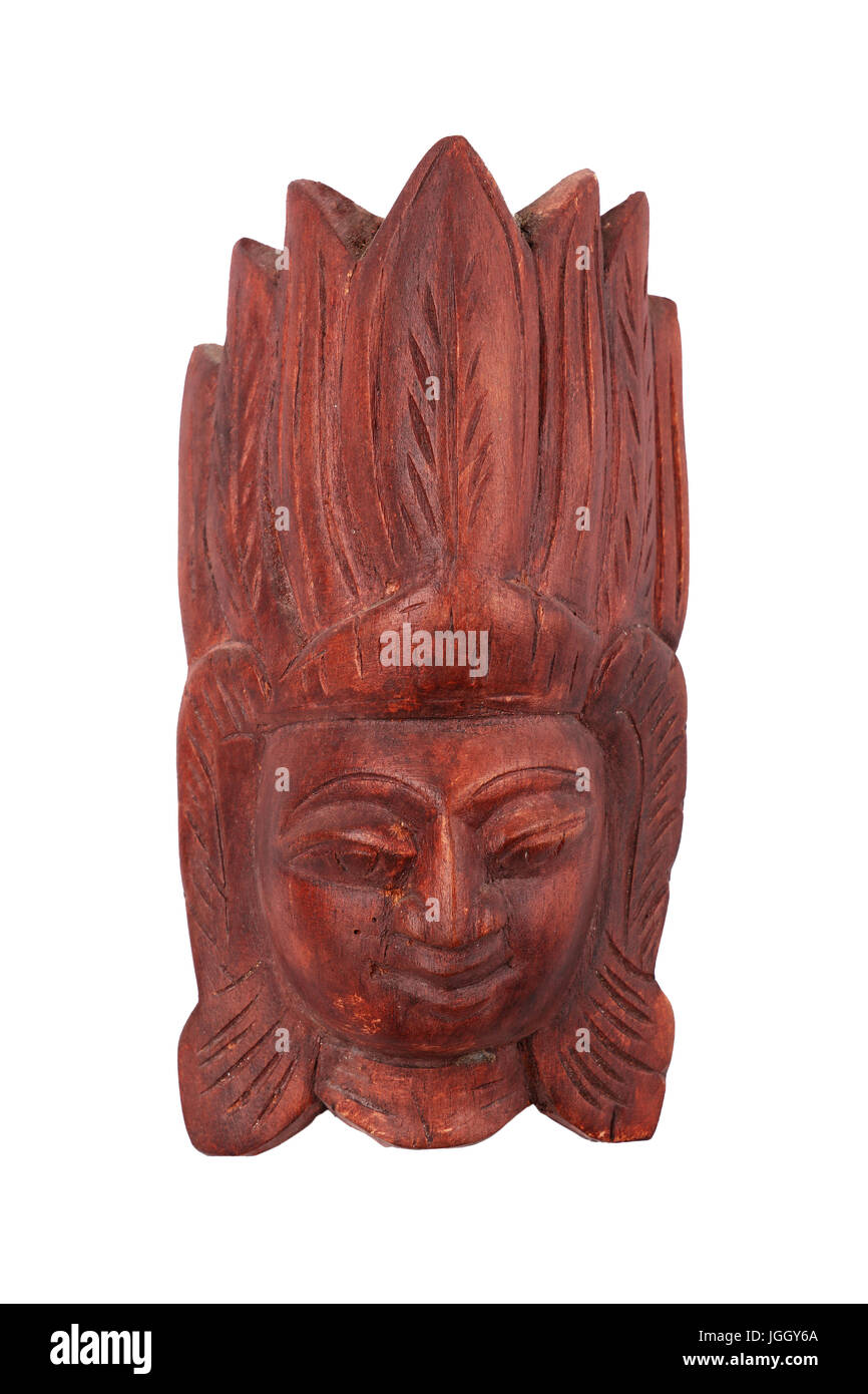 Wooden carved original Sri Lankan or Indian ethnic brown mask with human face, head of red wood isolated on white Stock Photo