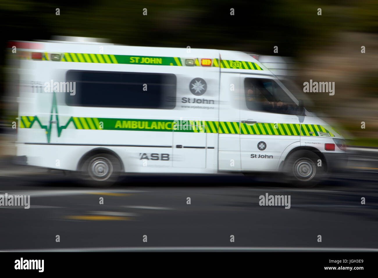 Speeding ambulance, Christchurch, Canterbury, South Island, New Zealand - Stock Image