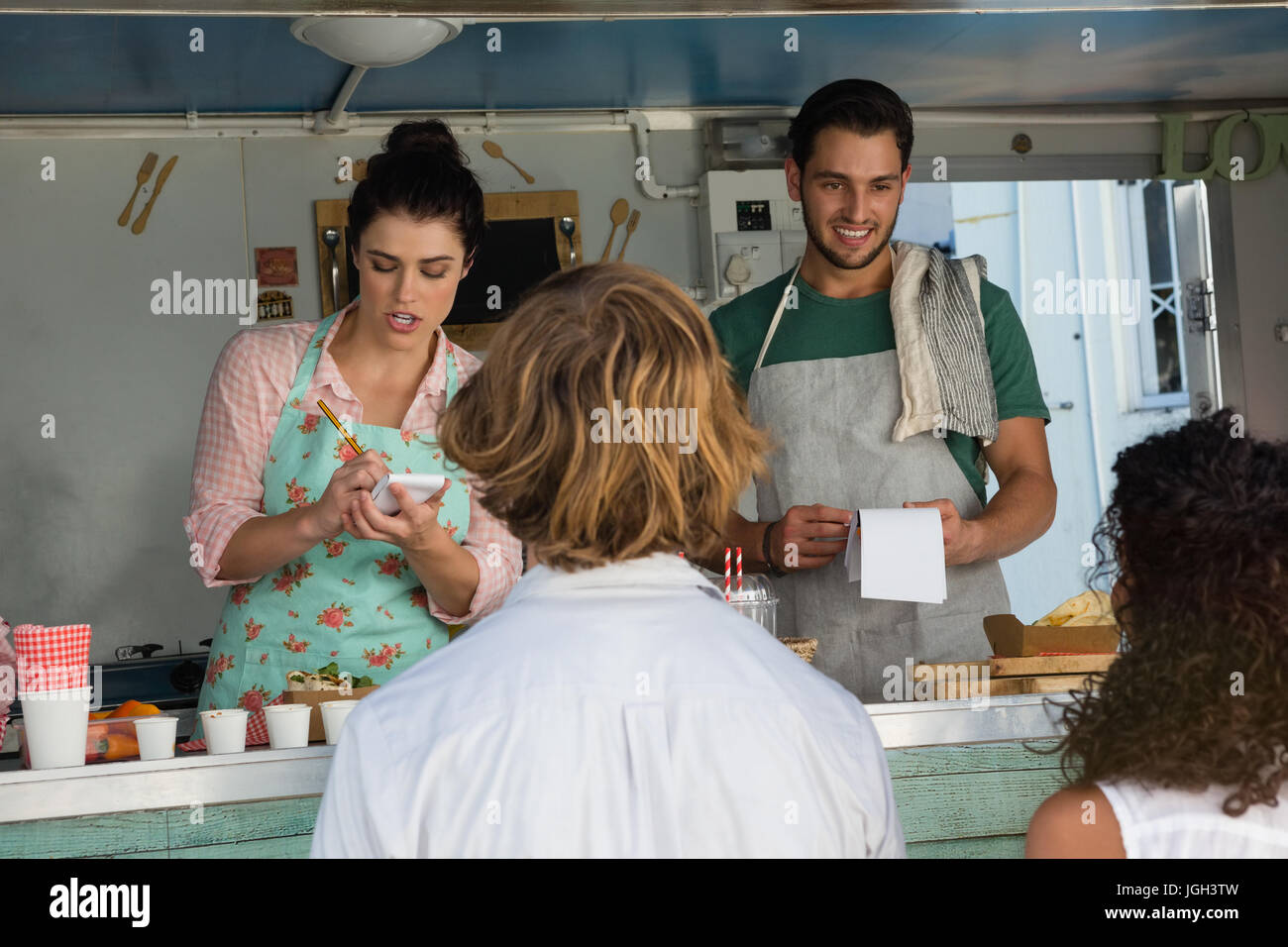 Ordering At Food Truck Stock Photos & Ordering At Food Truck