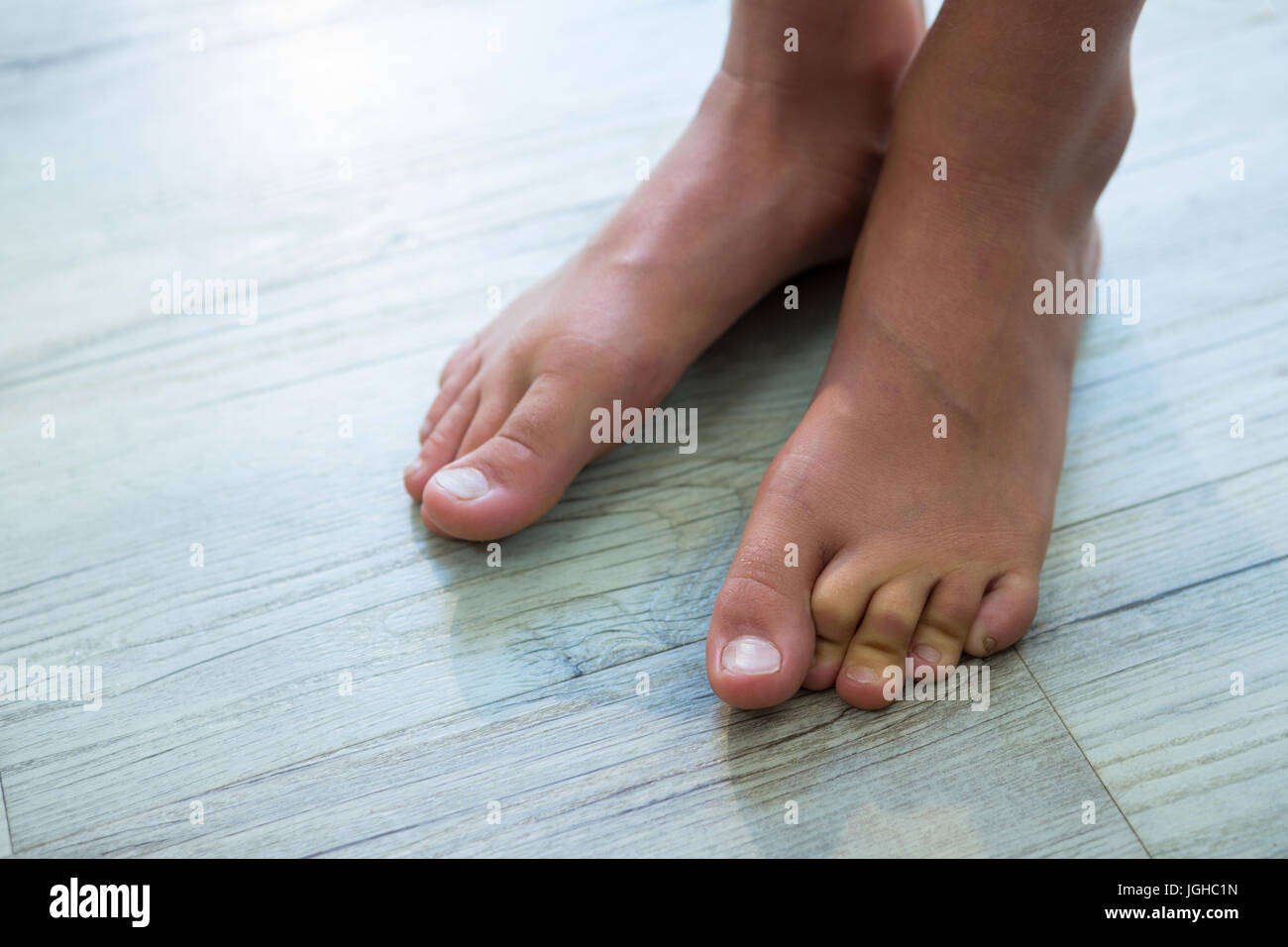 High angel view of girl standing on floor at home - Stock Image