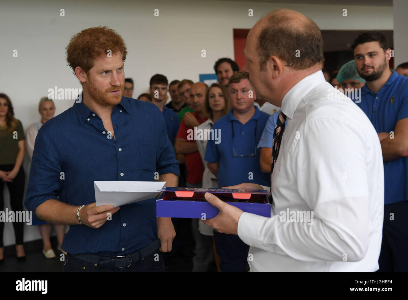 Prince Harry is presented with a specially-made box of sweets called 'Harry Mix' at the Haribo sweet factory on Stock Photo