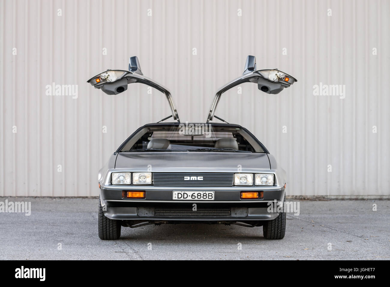 Adelaide, Australia - September 7, 2013: DeLorean DMC-12 car with opened doors parked on street near shed - Stock Image
