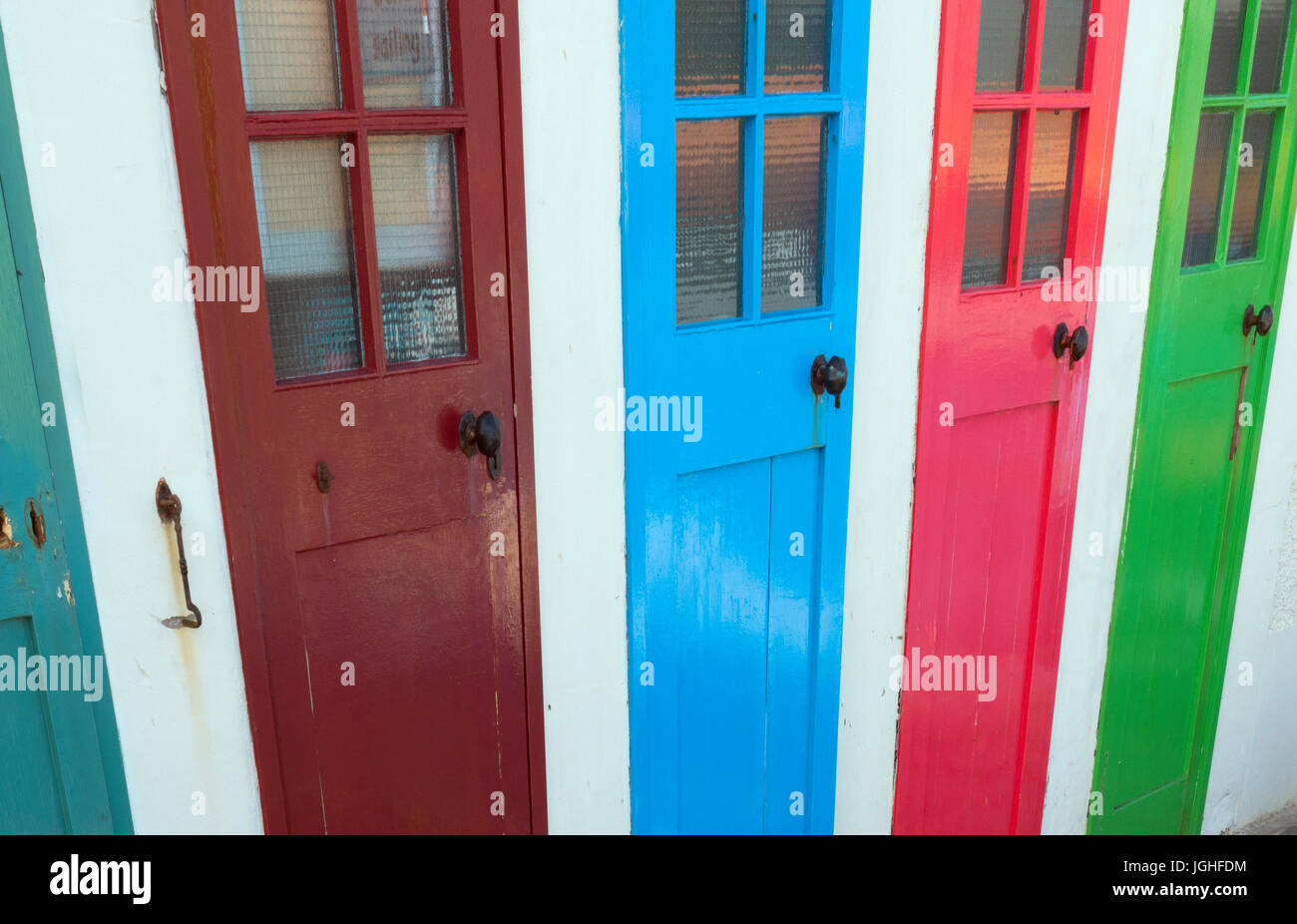 Colourful doors to former outdoor swimming pool changing rooms near the harbour at North Berwick & Colourful doors to former outdoor swimming pool changing rooms near ...