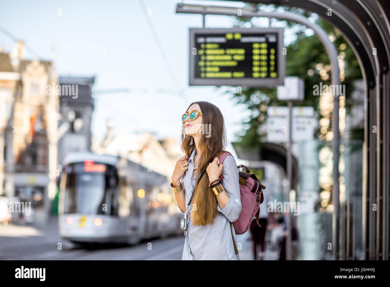 Woman on the tram station - Stock Image
