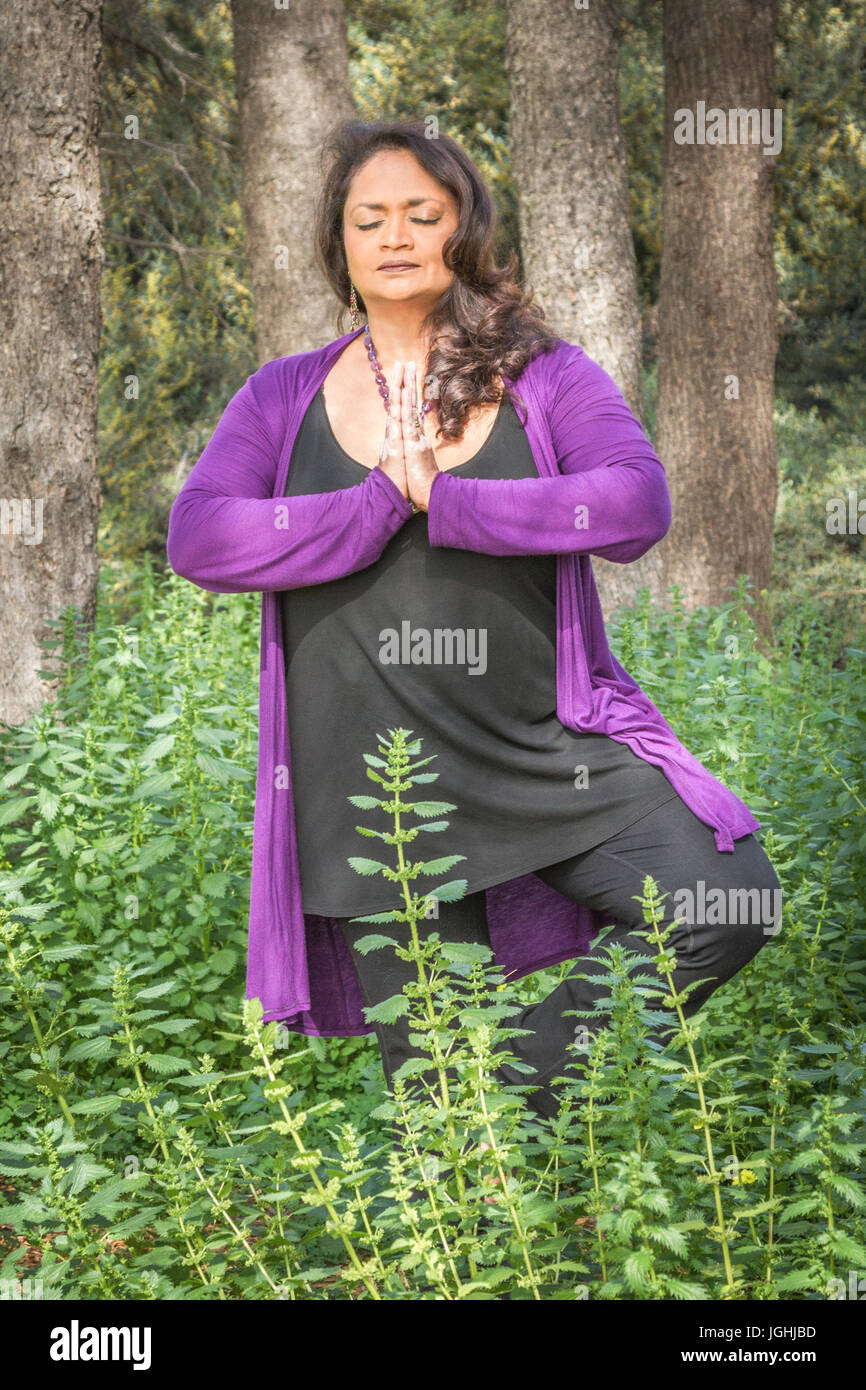 Middle Aged Indian Woman In Yoga Pose Outdoors In Forest Elbows Out Stock Photo Alamy