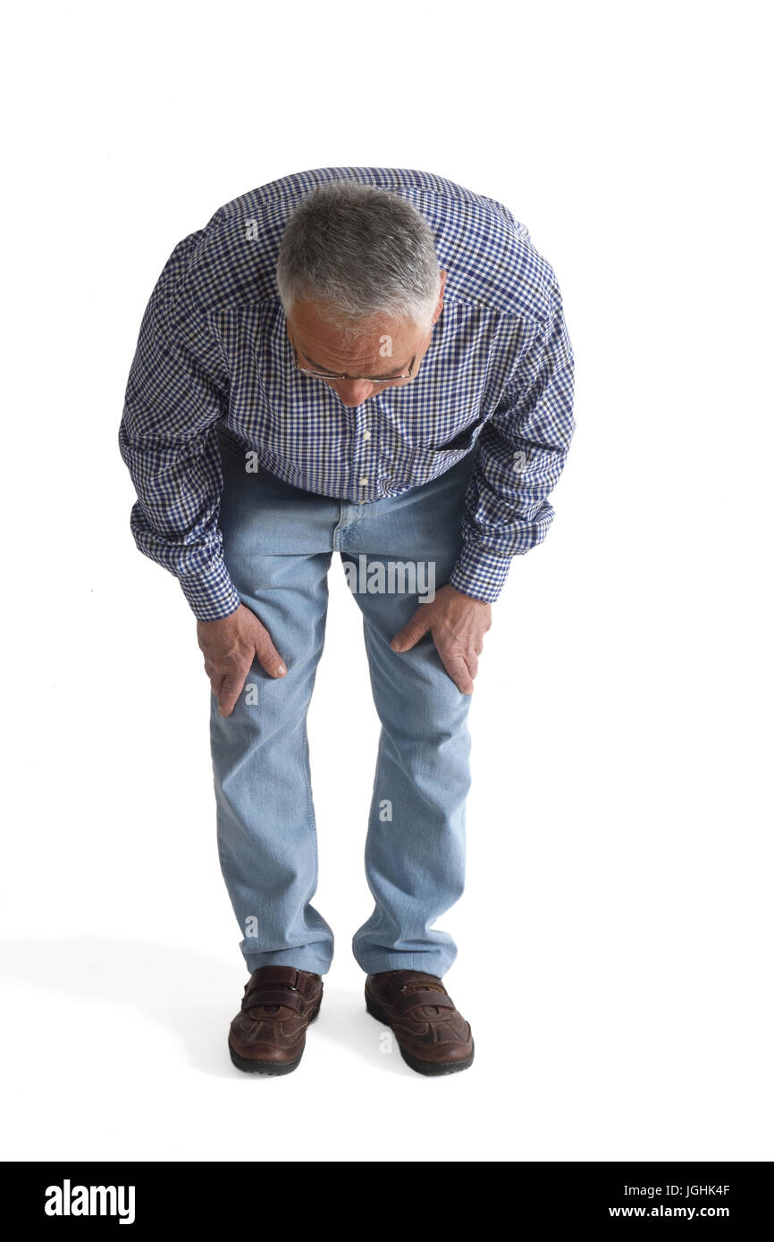 Man looking for a thing he has lost - Stock Image