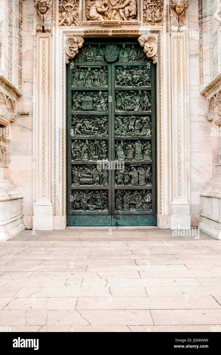 Side door of Milan Cathedral (Duomo di Milano). Milan, Province of Milan, Italy. 08.12.12 - Stock Image