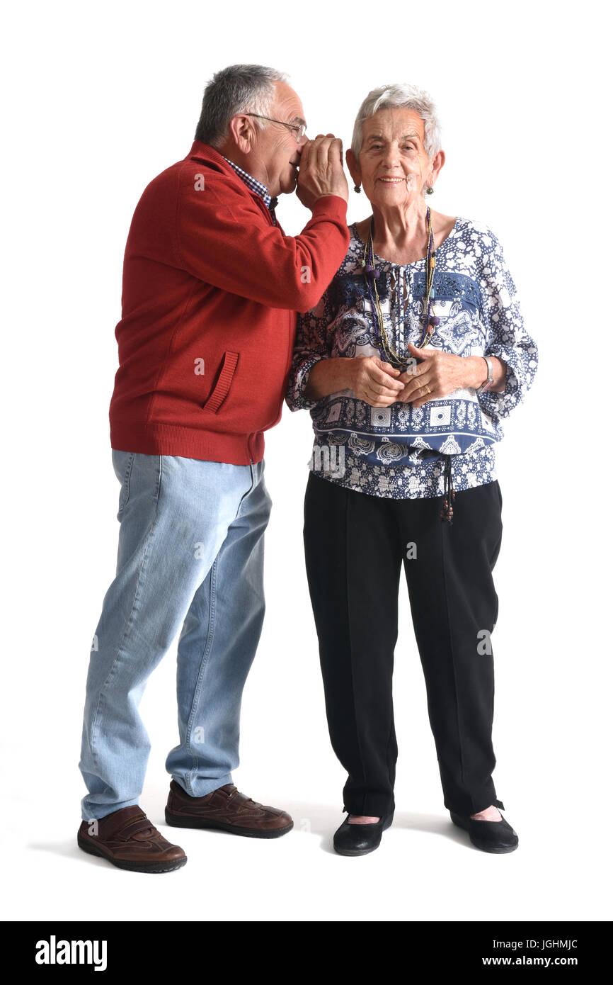 secrets senior couple on white - Stock Image