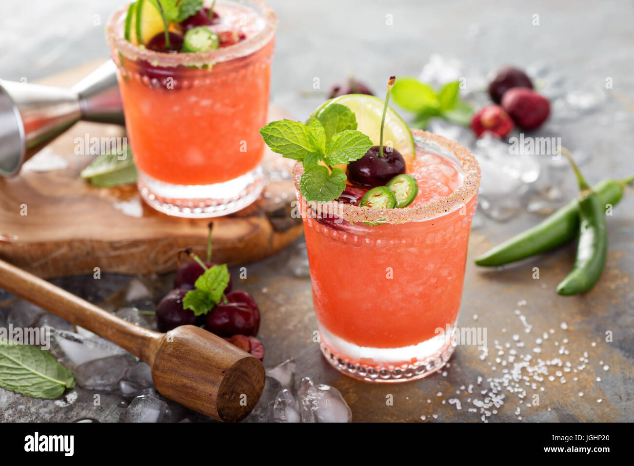Refreshing summer cocktail with cherry - Stock Image