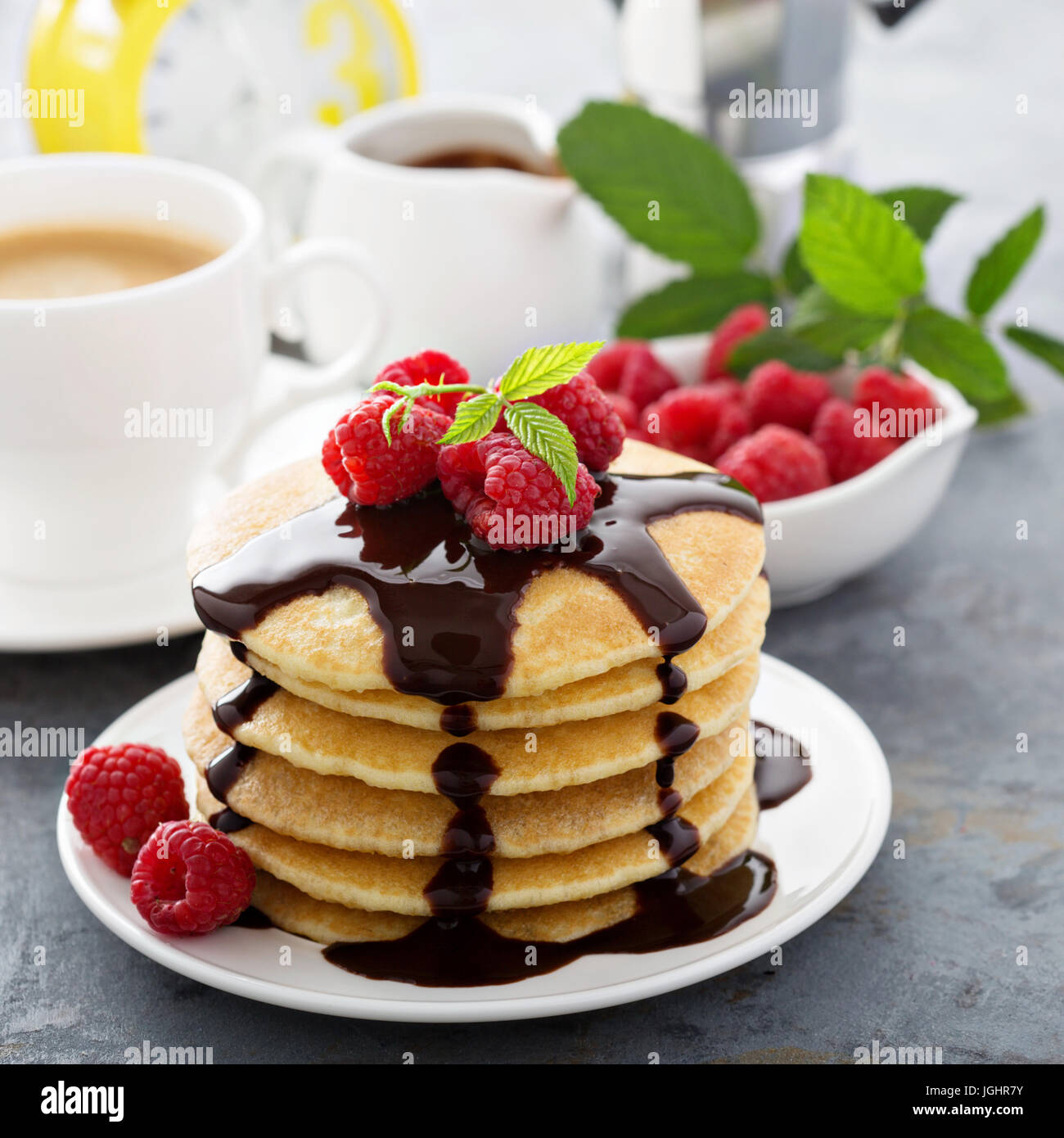 Stack of fluffy buttermilk pancakes with chocolate - Stock Image