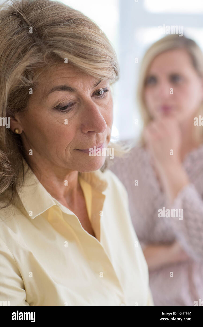 Serious Mature Woman With Adult Daughter At Home Stock Photo