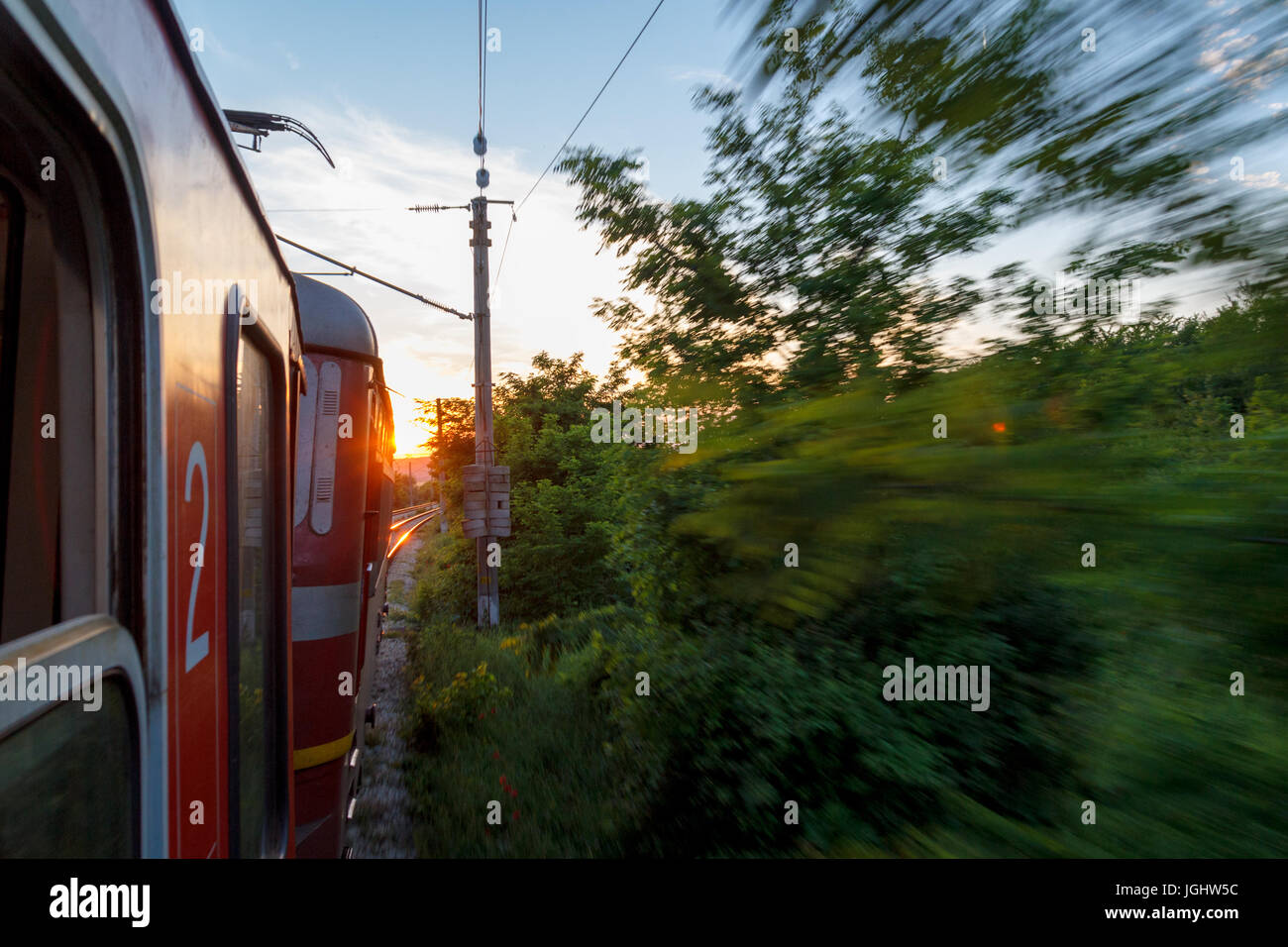 OUTSIDE OF AN OLD MOVING TRAIN - Stock Image