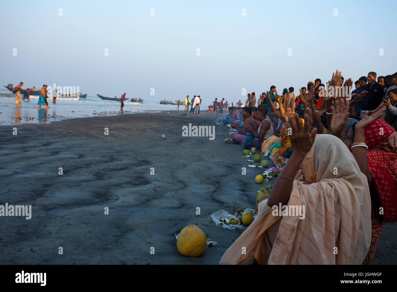People from the Hindu community offer Morning Prayer at the shore of