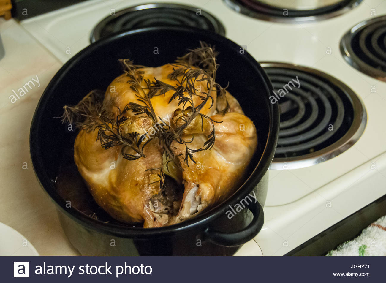 Chicken roasted with rosemary fresh out of the oven. Home cooked. Stock Photo
