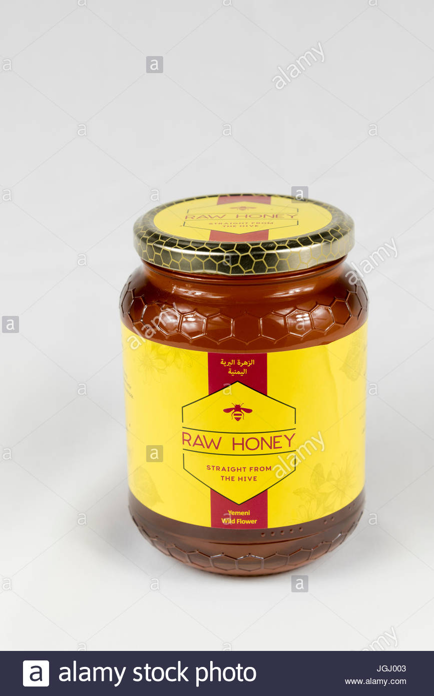 Jar of Raw Honey (wild flower) pruduced in Yemen, Middle East - Stock Image