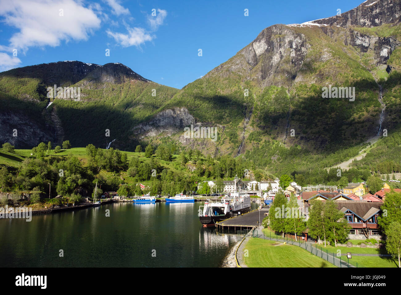 Scenic view to village at end of Aurlandsfjorden on west coast in early summer. Flam, Aurland, Norway, Scandinavia - Stock Image