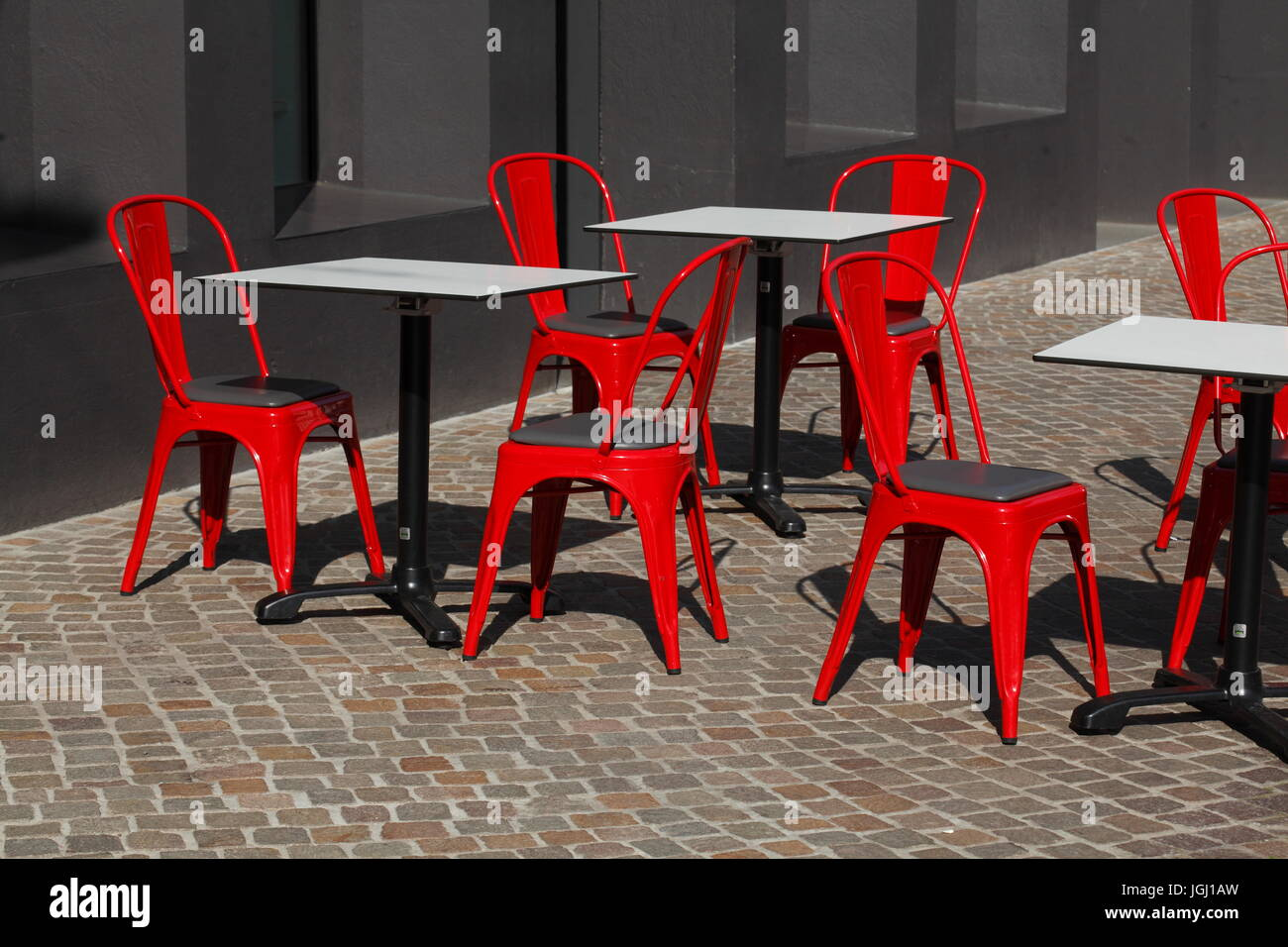 Red Metal Chairs And White Tables