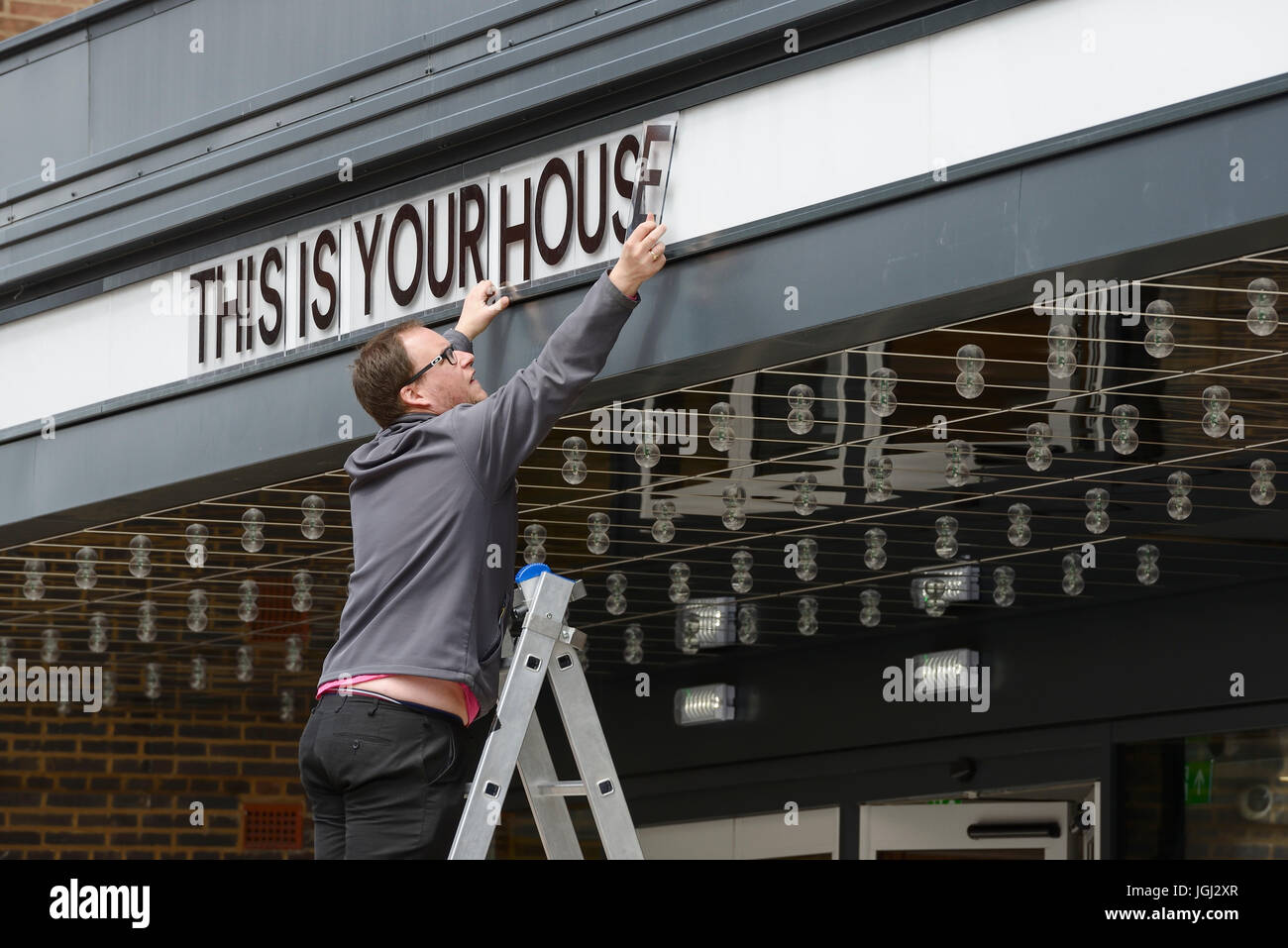 The front of house signage being updated at the Storyhouse arts venue in Chester city centre UK Stock Photo