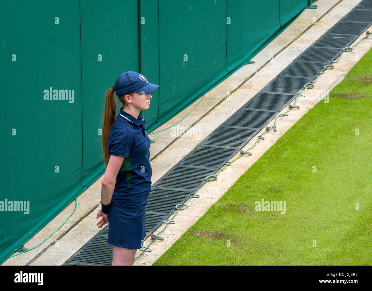 Close up of ball girl on No 3 Court, standing to attention, Wimbledon tennis championship 2017, London, England, - Stock Image