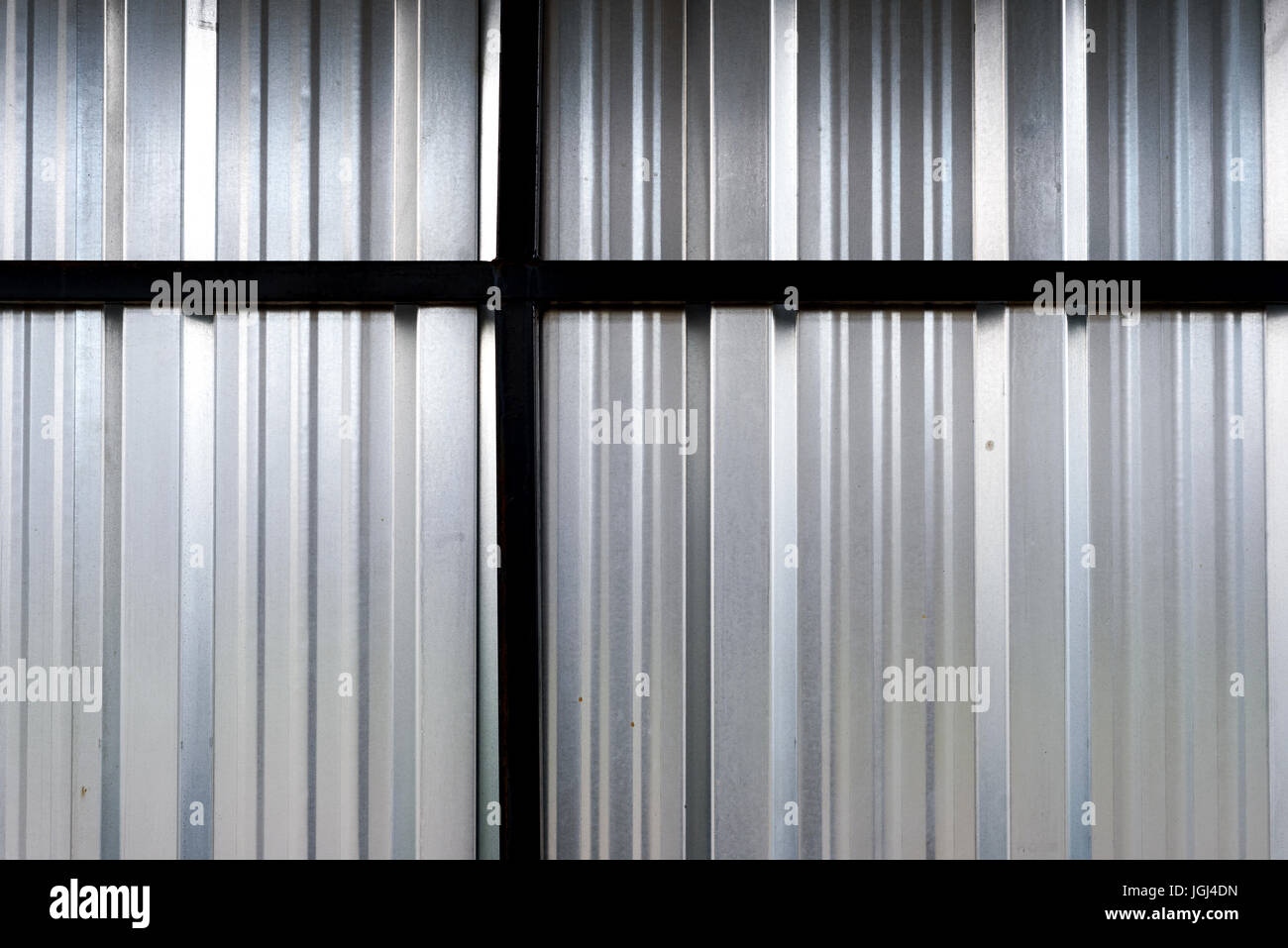 Horizontal and vertical stripes in aluminum sheet metal with reflected light - Stock Image