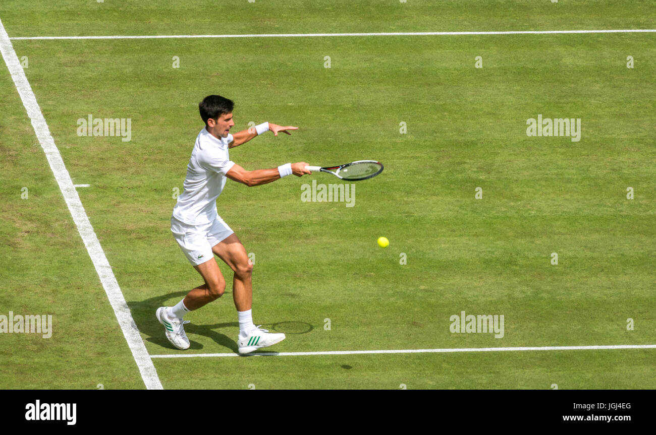 Awkward return of tennis ball by Novak Djokovic on Centre Court Wimbledon tennis championship 2017, London, England, - Stock Image