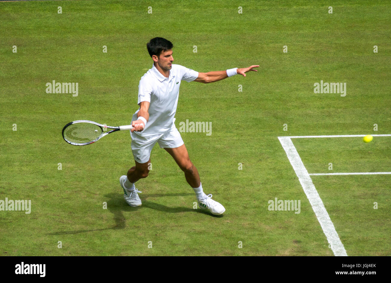 Novak Djokovic returns serve on Centre Court Wimbledon tennis championship 2017, London, England, UK - Stock Image