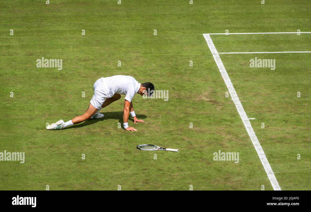 Novak Djokovic slips and falls on Centre court Wimbledon tennis championship 2017, London, England, UK - Stock Image