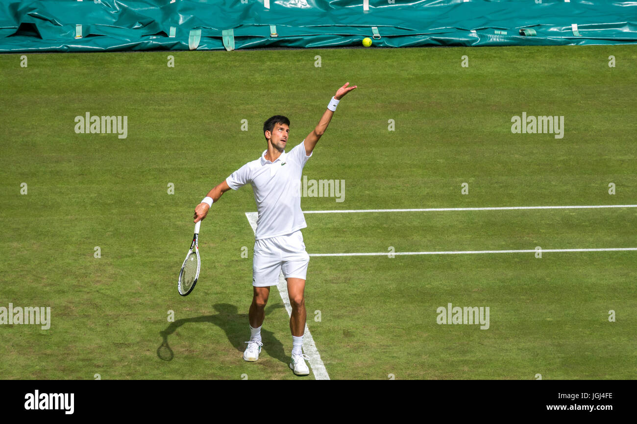 Novak Djokovic serves on Centre Court, Wimbledon tennis championship 2017, London, England, UK - Stock Image