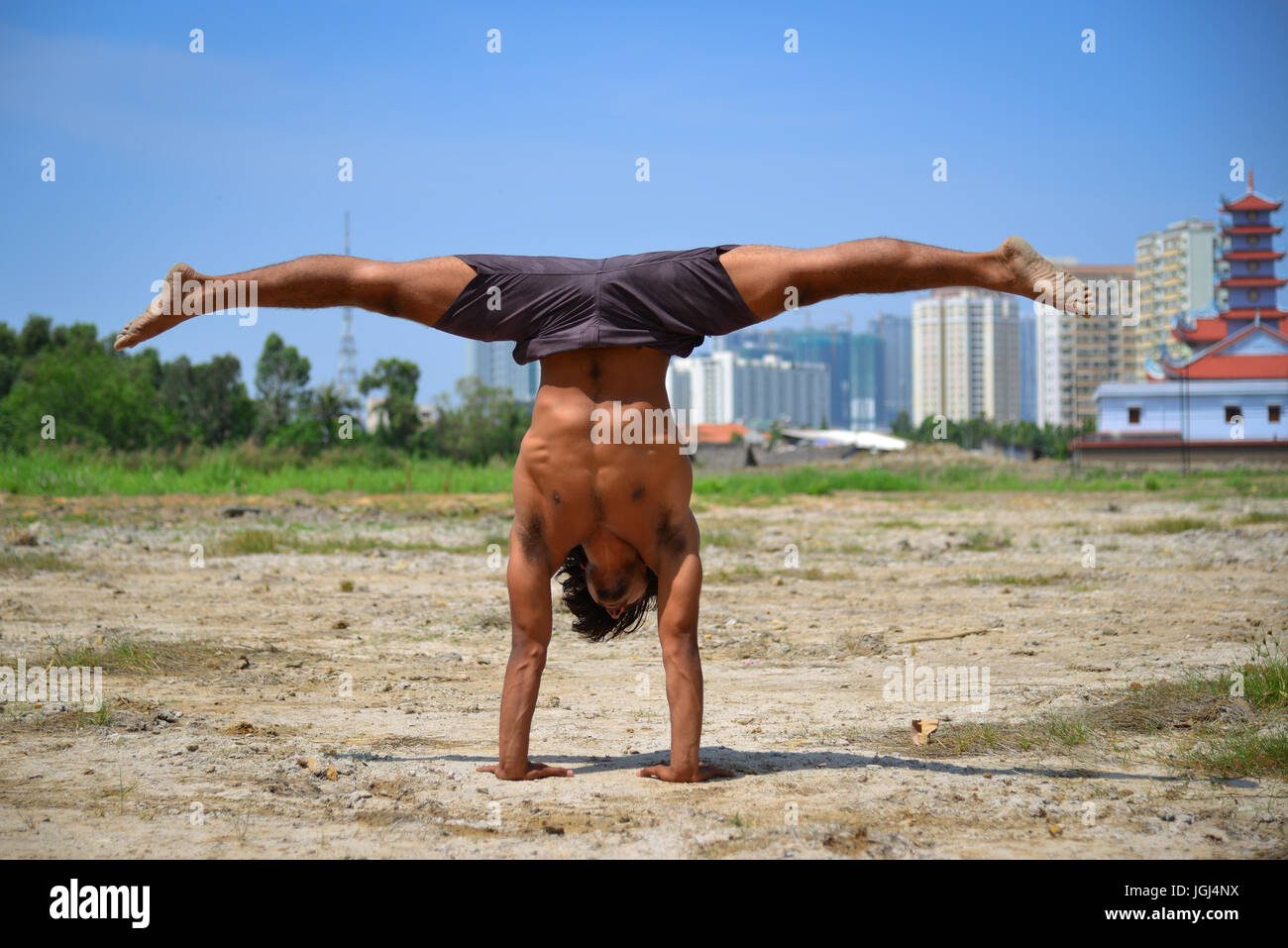 An Indian Man Doing Yoga Poses At Summer With Cityscape Background Stock Photo Alamy