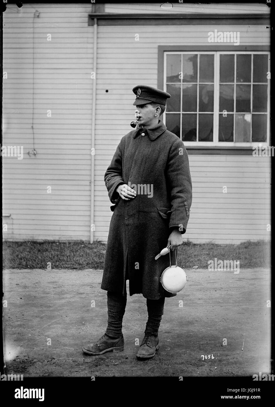 Canada in WWI - Man in military overcoat with mess kit - Stock Image
