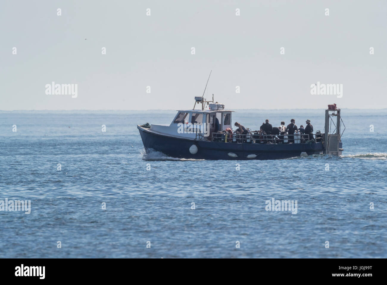 Dive boat off the Farne Island, Northumberland UK Stock Photo