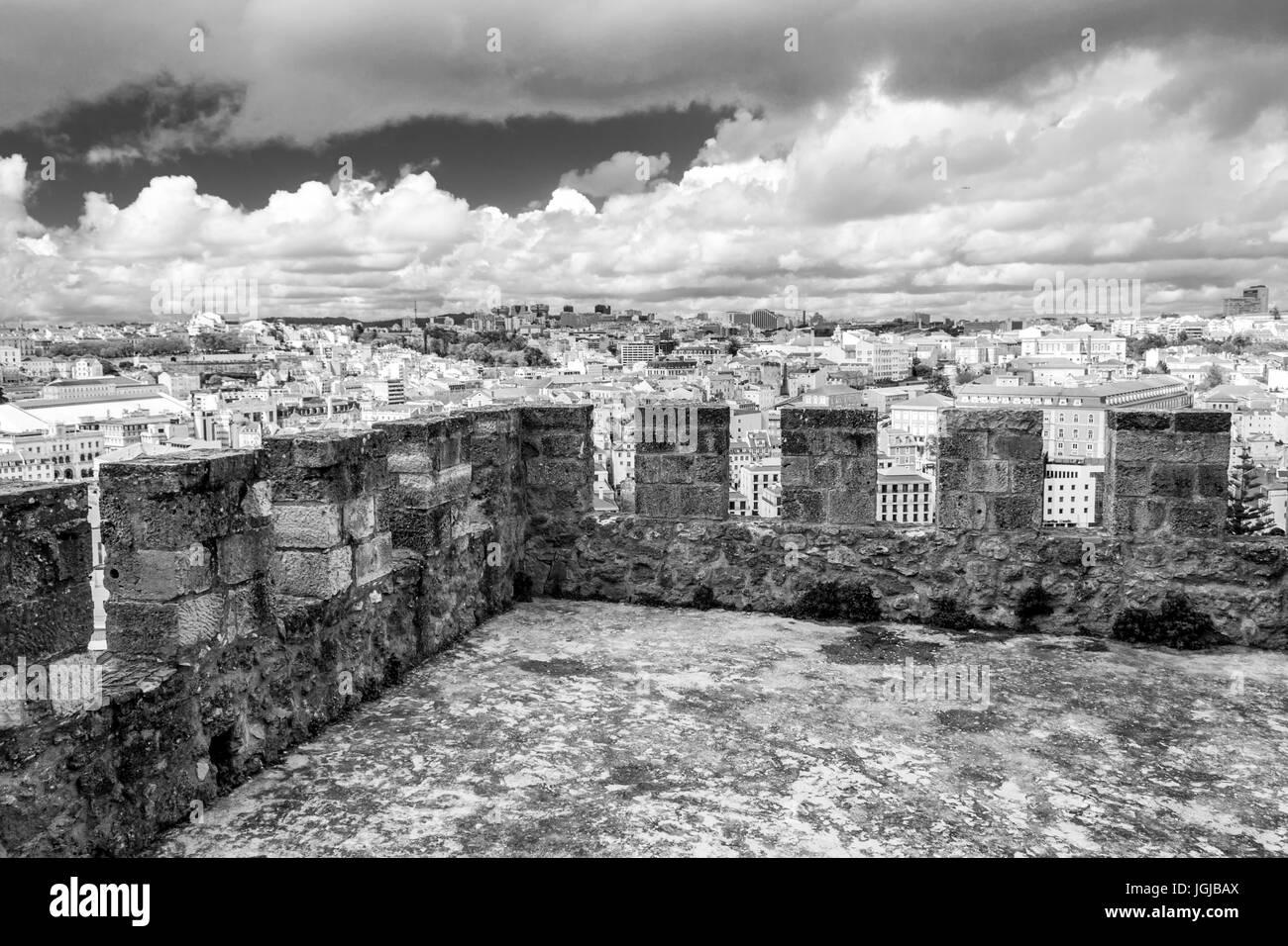 Castelo de Sao Jorge is located on a hilltop overlooking historic Lisbon (Portugal) - Stock Image