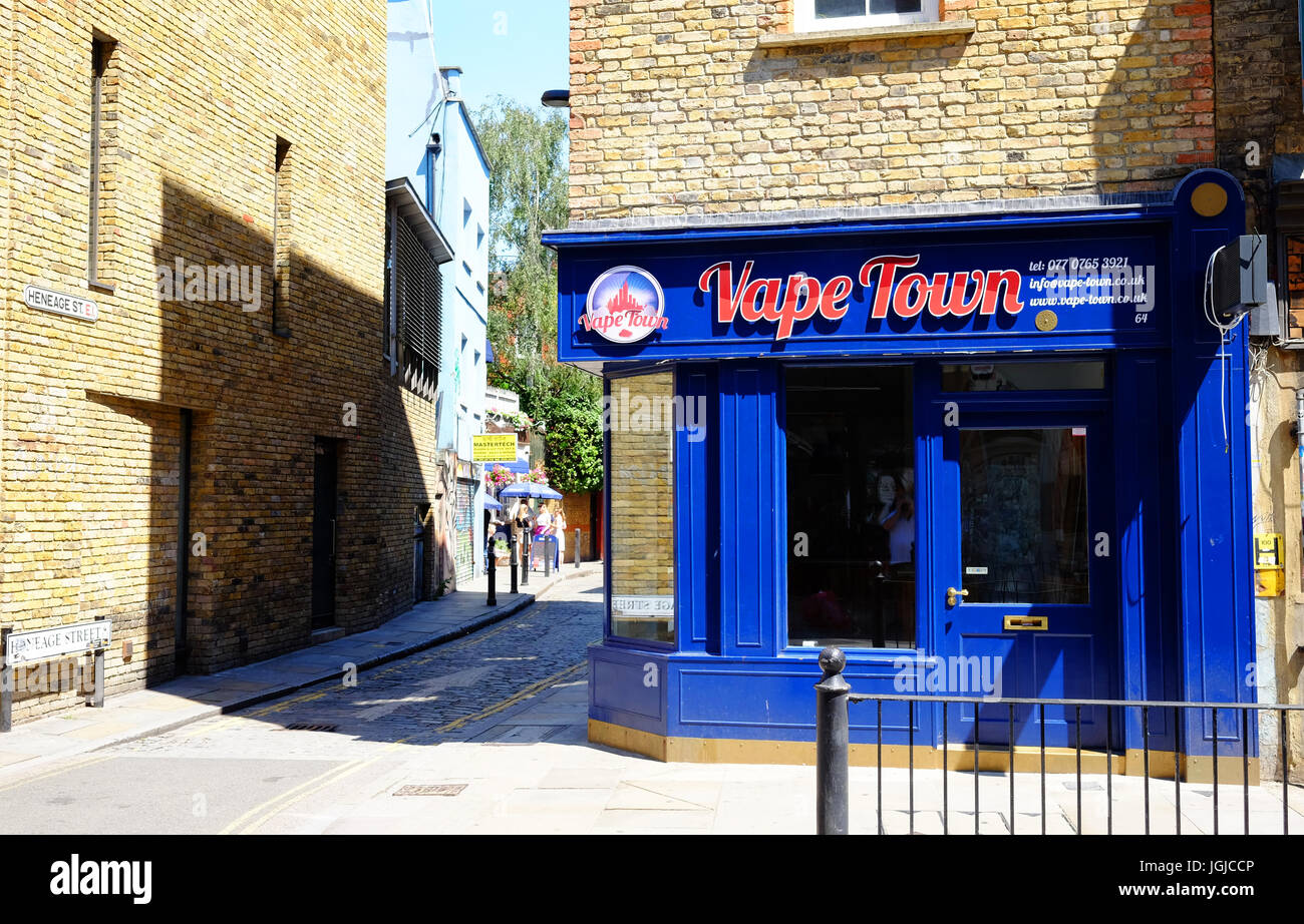 Vape Town shop in Brick Lane, Shoreditch, London E1, supplying e-cigarettes, showing the changing shops on the High - Stock Image