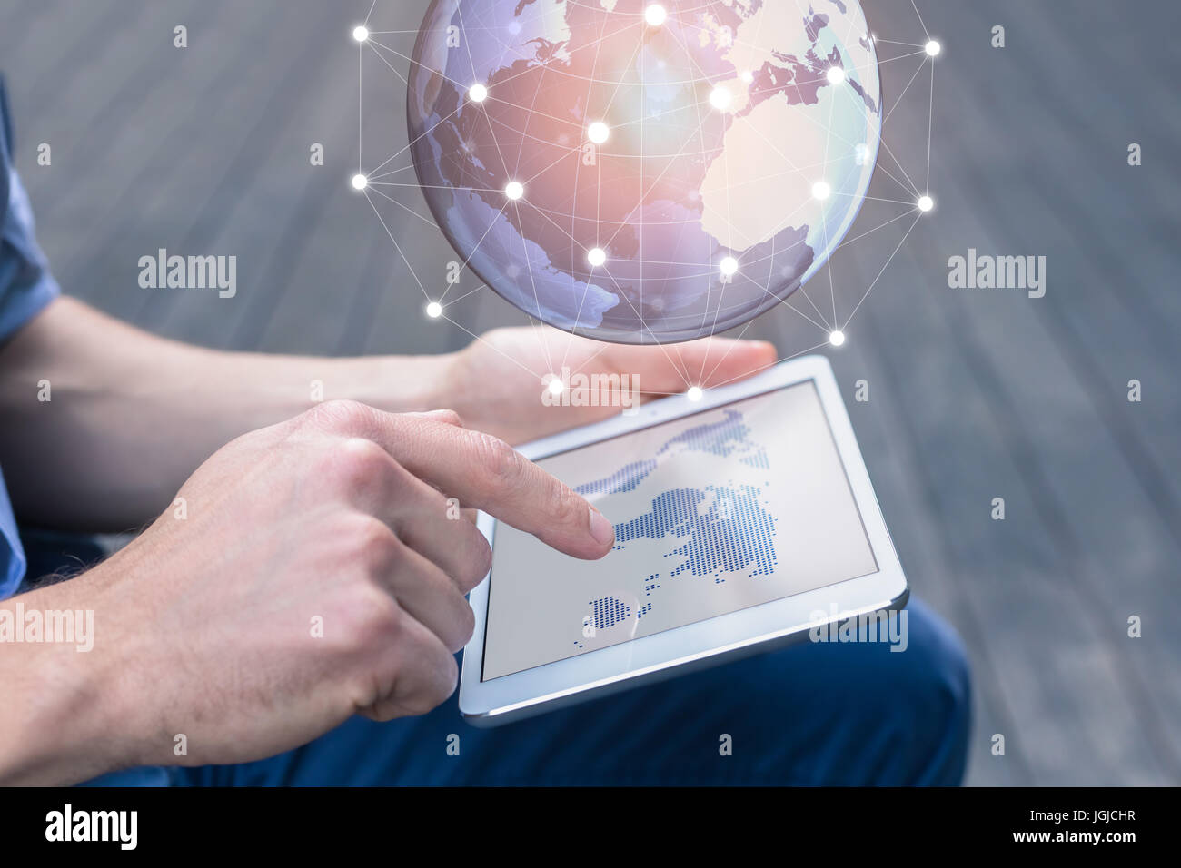 World wide business concept with a person using a digital tablet computer with augmented reality (AR) to visualize - Stock Image