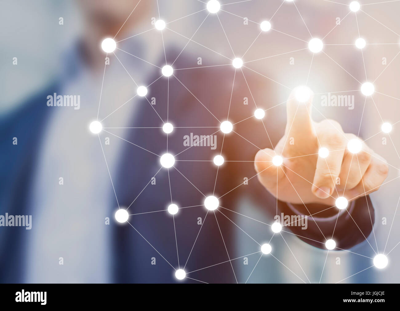 Person touching a network chart showing connections between nodes or servers, concept about the world wide web internet - Stock Image