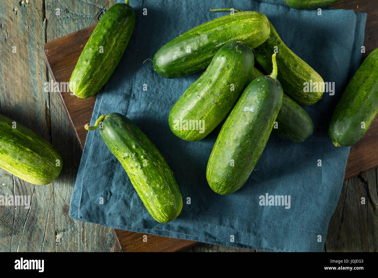 Raw Green Organic PIckle Cucumbers Ready to Eat - Stock Image