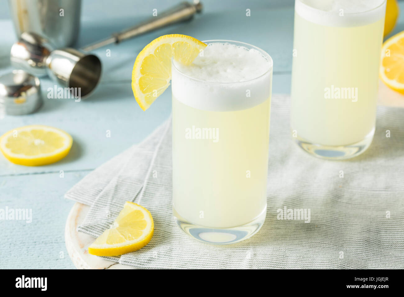 Refreshing Cold Egg Gin Fizz with a Lemon Garnish - Stock Image