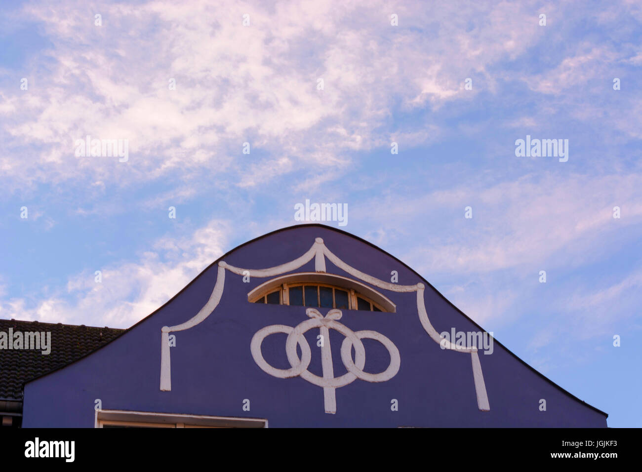 House gable, residential house facade with stucco work. - Stock Image