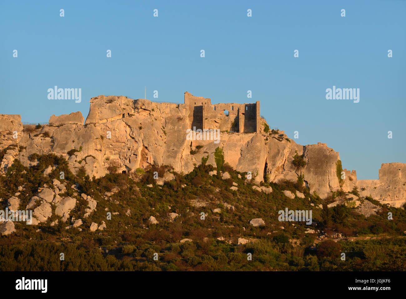 Sunrise over the Eastern Facade of the Ruined Castle Les Baux or Les Baux-de-Provence Hilltop Village Castle in - Stock Image