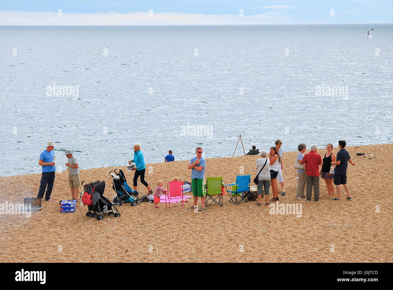 Chesil Beach, Dorset, UK. 7th July, 2017. People enjoy barbecues on a balmy Chesil Beach, West Bexington, as the - Stock Image