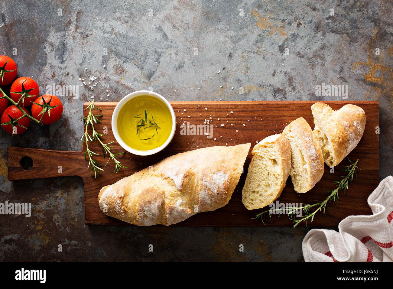 Homemade baguette with olive oil and salt - Stock Image