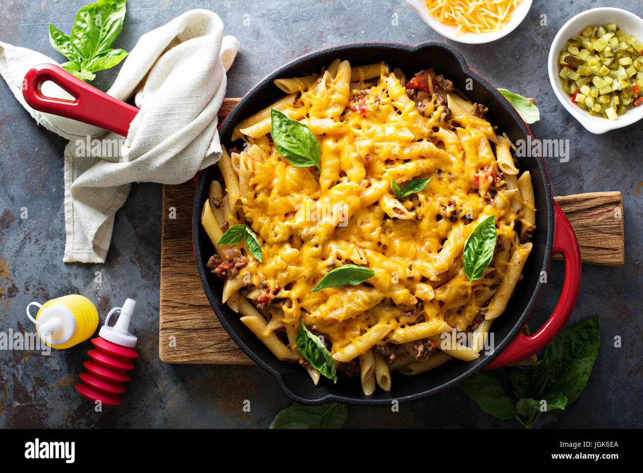 Cheesy pasta bake with ground beef and herbs - Stock Image