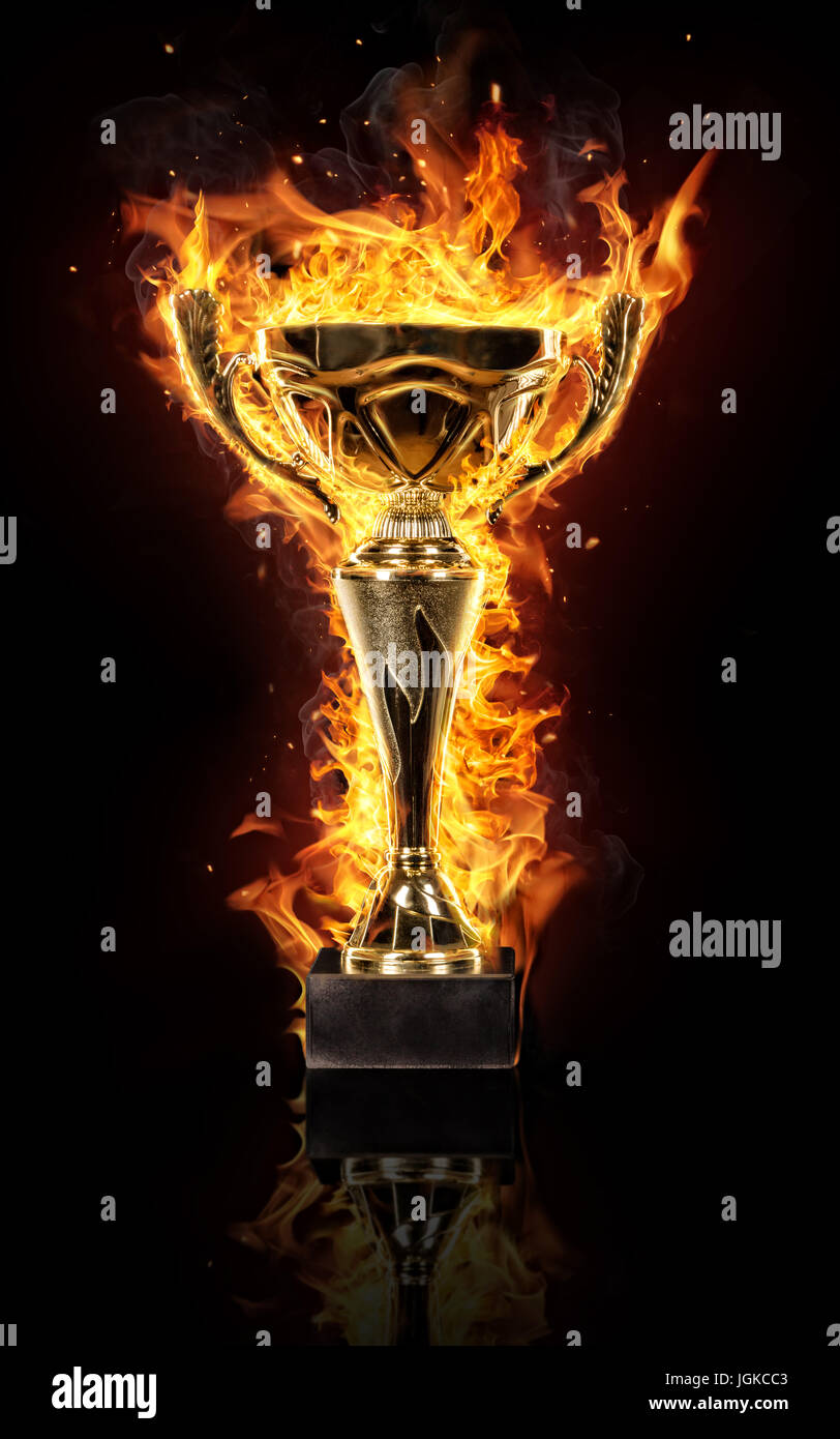 Burning Gold Trophy Cup Isolated On Black Background Flames Around Concept Of Success And Effort