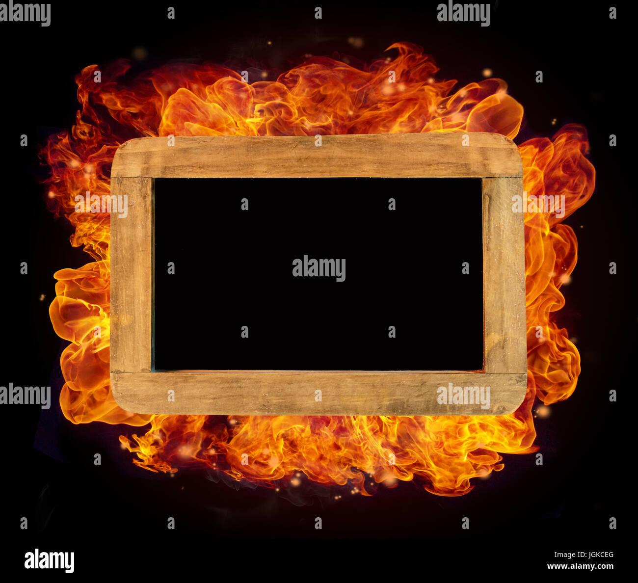 Old wooden small chartboard in fire with free space for text Stock Photo