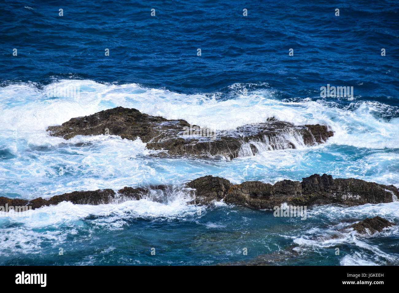 Waves breaking over rocks at Fonte Da Areia, Porto Santo, Portugal - Stock Image