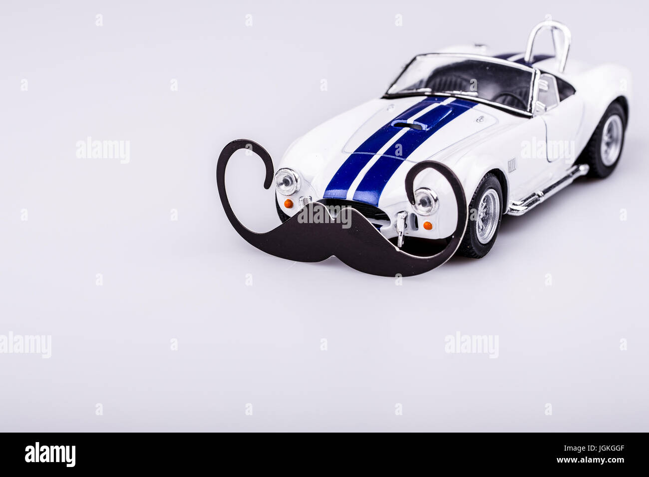 bautiful blue and white car, roadster with mustache - male car for movember - Stock Image