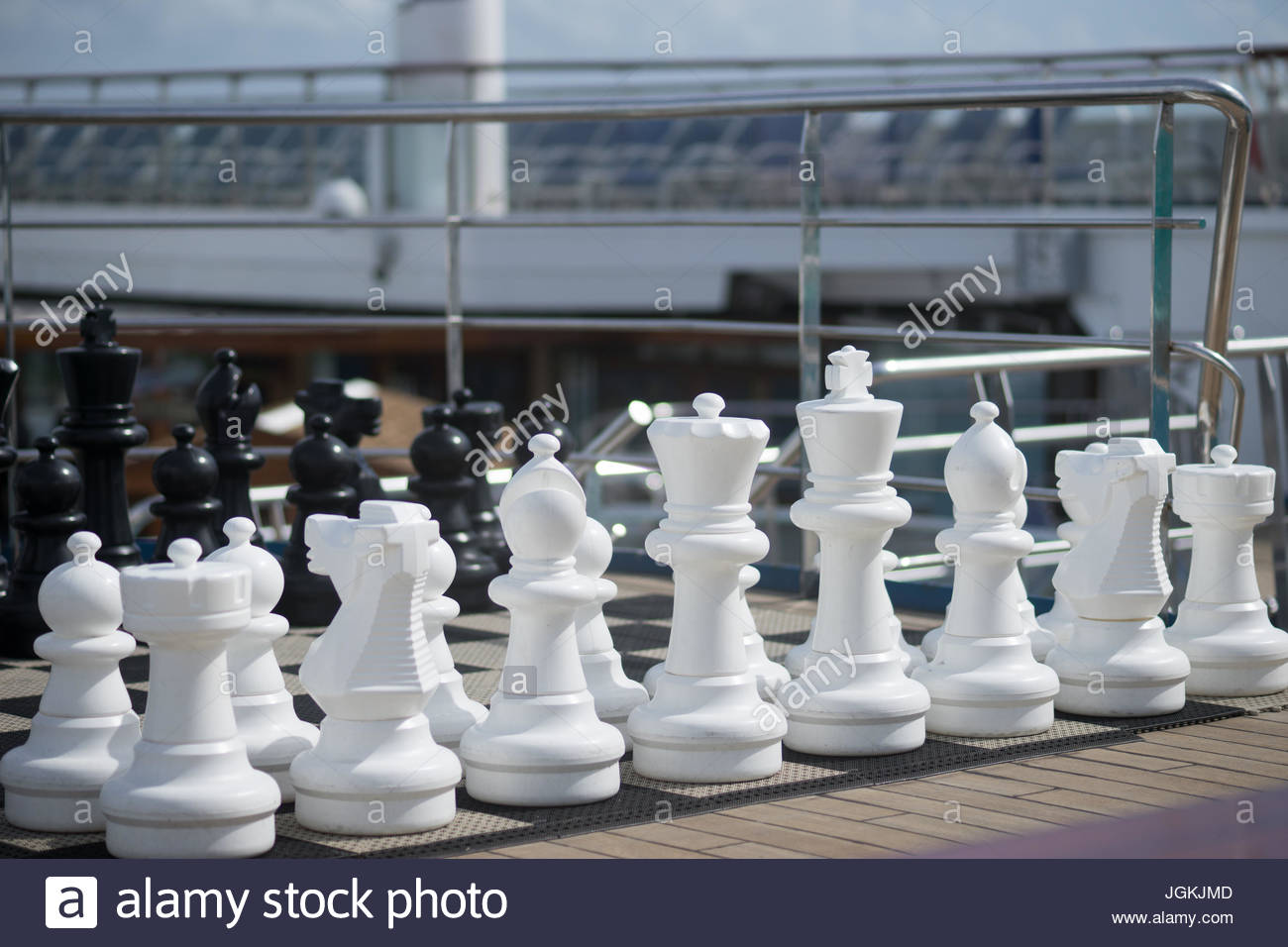Big chessmen are available for passengers on a cruise ship in the caribbean to play - Stock Image