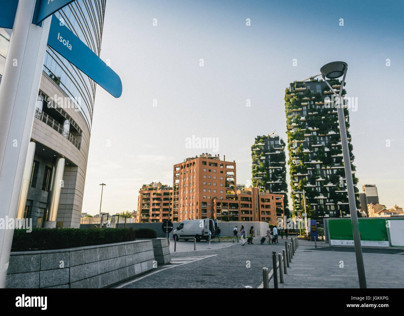 A sign towards the Isola neighbourhood with Milan's iconic Bosco Verticale Stock Photo