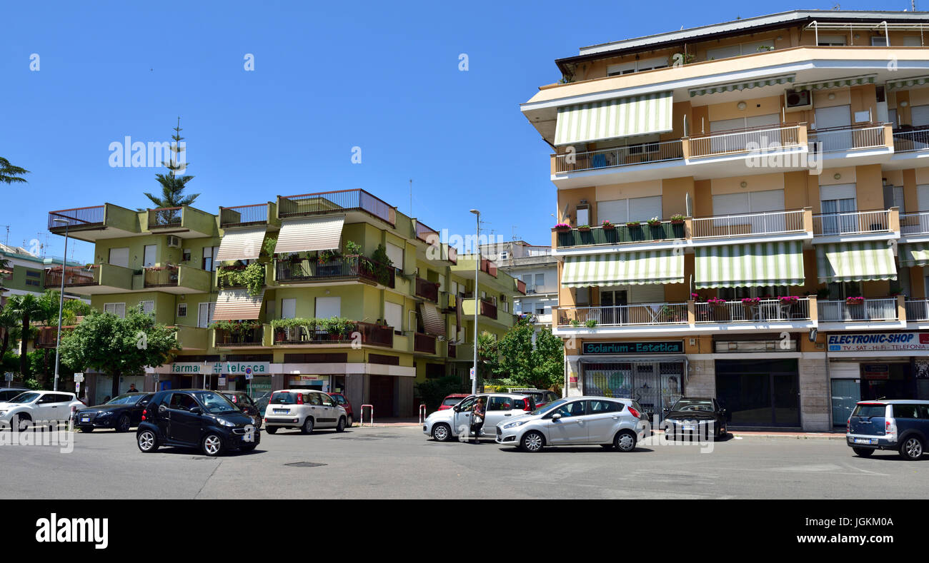 Typical ordinary apartments / flats above shops in central Terracina, Italy - Stock Image