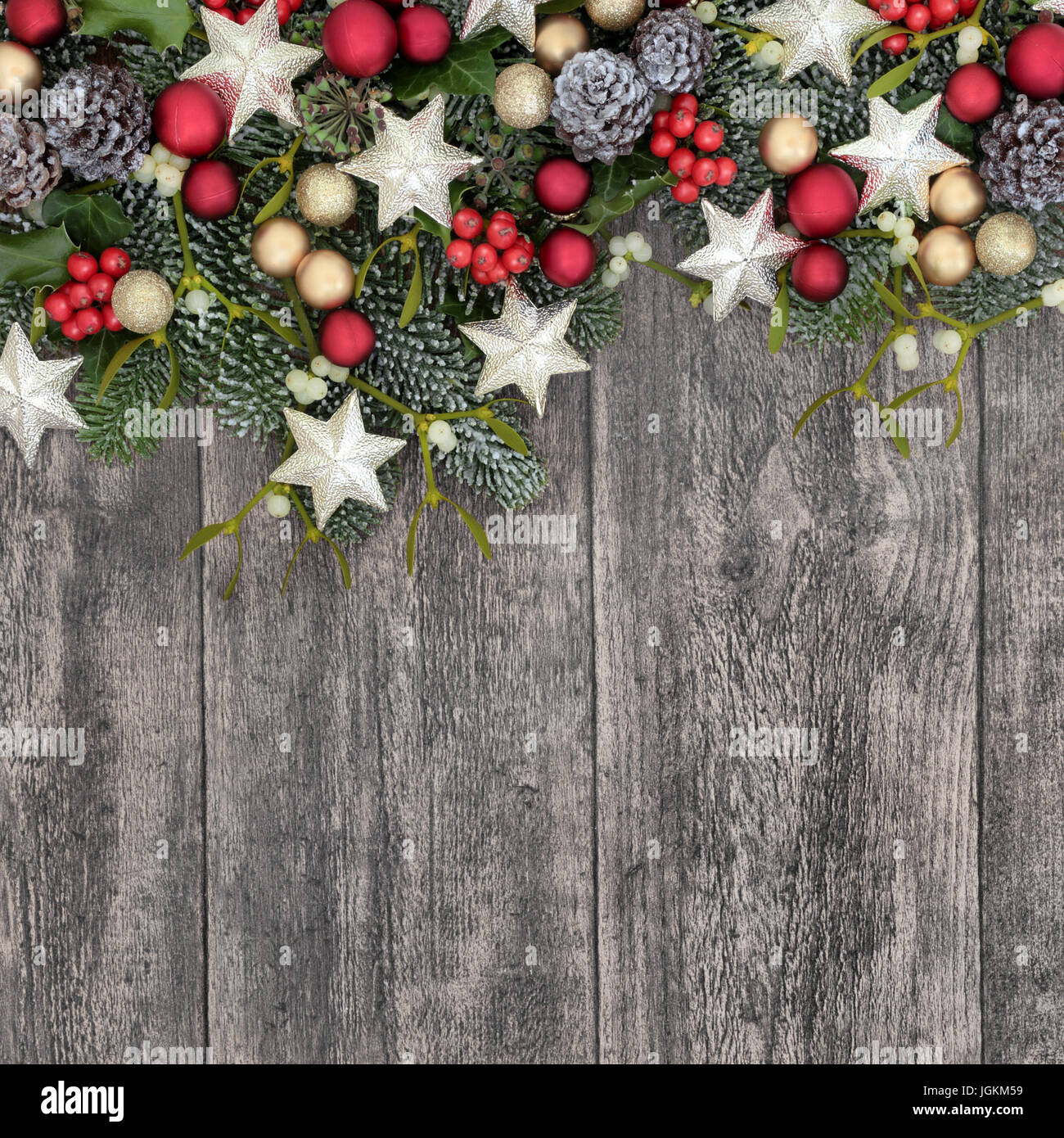 Christmas Background Border With Bauble Decorations Holly Ivy Mistletoe Fir And Pine Cones On Old Wood